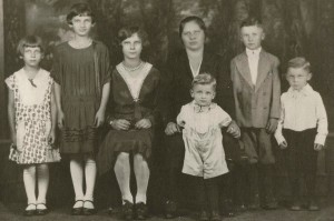 My grandmother is sitting to the right of her mother, Anna Semko, who became Anna Melnyk. Baba Melnyk, twice widowed, raised hell, a bountiful garden and seven children in her company house on 20 Row.