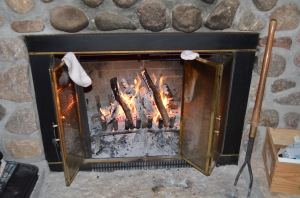 Those are Molly's socks drying by the fire. She could feel her toes again this morning.