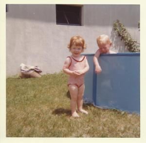 My dad caught this early episode of redheaded discrimination when I was 16-months old and my brother refused to let me in the swimming pool.