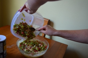 Fold the rhubarb into the filling mixture...