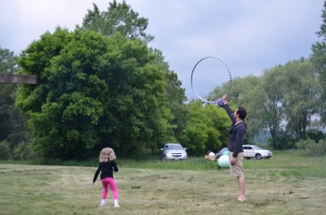 As it turns out, there are lots of  ways to use a hula hoop. Great fun!