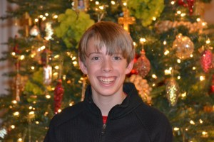 This is my nephew Michael at Christmas this year. By the end of the holiday he had grown taller than the tree.