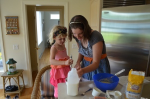 Molly gave Erin a quick lesson in the acidity of raspberries and how they activate the baking soda.