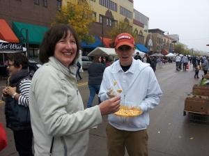 Aunt Donna taste a nice fresh cheese curd at the Appleton Farmer's Market.