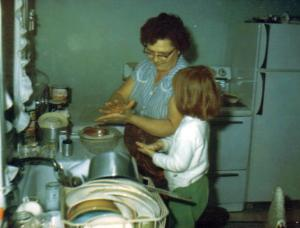 This kitchen never changed, and the woman who reigned over it didn't either. This is Baba and me in her Colver PA kitchen, circa 1967.