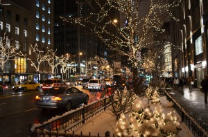 City sidewalks busy sidewalks . Dressed in holiday style In the air There's a feeling of Christmas