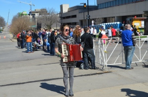 Where else but Wisconsin would a serene woman with a red accordion provide accompaniment to a race/farmer's market?
