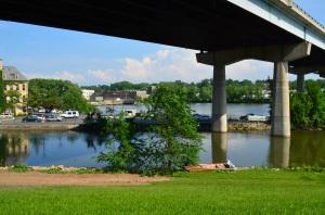 Orange boat under the bridge