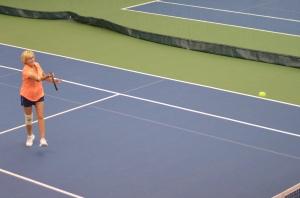 Mom playing tennis