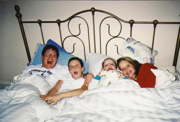Vinnie Charlie Katherine and Molly in the big bed